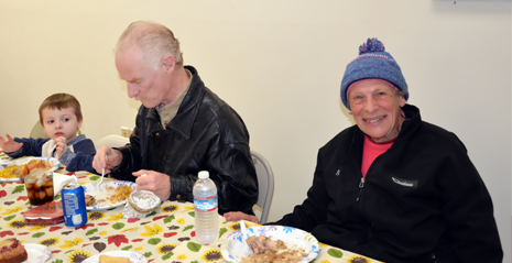 Child and Elderly People Eating